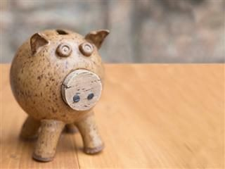old ceramic piggy bank on a table