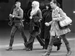 four women walking down a street