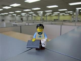 programmer lego doll in office