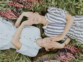 twins covering each others eyes