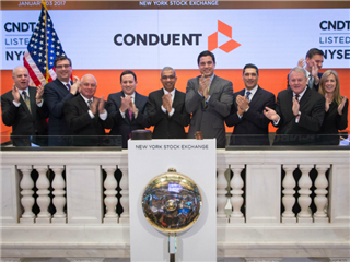 The Conduent team rang the bell at the New York Stock Exchange on Jan. 3, 2017.