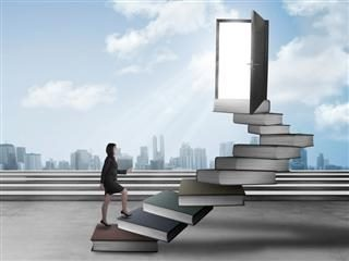 CMO marching up a stairway made of books to an open door with sunlight pouring out