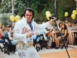 Elvis impersonator entertaining a party