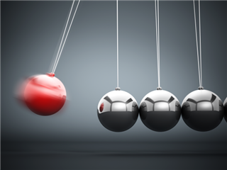 A Newton's Cradle, with one sphere is about to impact 3 silver spheres - Impact concept