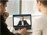 Marketing analysts participate in a video conference with their boss discussing business goals - remote worker concept