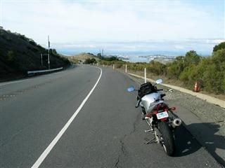 A riderless motorcycle on the side of the road.