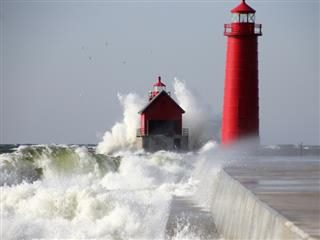 lighthouse during daytime in rough seas