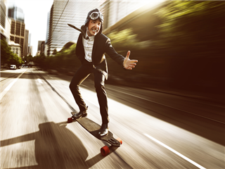 A marketing strategist using a long skateboard to get to work - marketing personalization concept