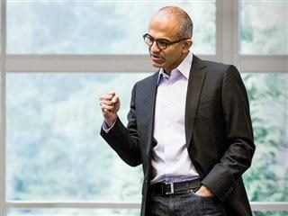 Microsoft CEO Satya Nadella pumps his fist.