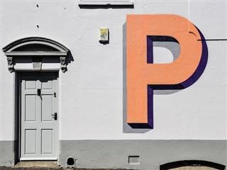 large letter P on a grey wall