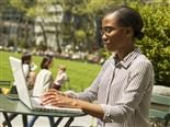 woman working on a laptop in a park