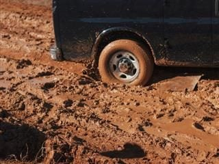 truck with a tire stuck in the mud
