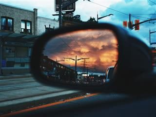 sunset as viewed in a rearview mirror