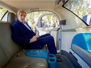 Former Secretary of State John Kerry in a Google Self-Driving Car