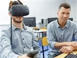 Young man in a technology lab using virtual reality headset - vr training concept