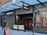 customer walking out of the Amazon Go store in Seattle
