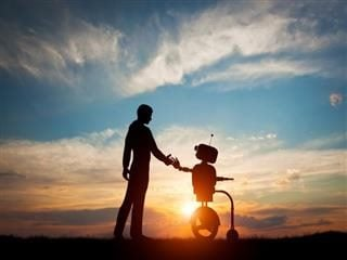 Future interaction with artificial intelligence, man and robot meet and handshake