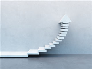 Ascending stairs on white wall with an arrow head pointing upward - metric improvement concept