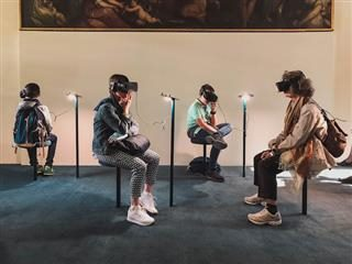 room full of people wearing virtual reality headsets