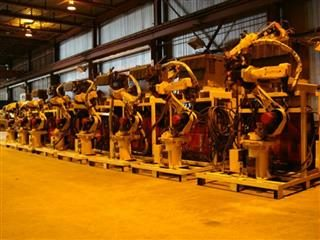 Kitmondo process and packaging machinery lined up in a row.