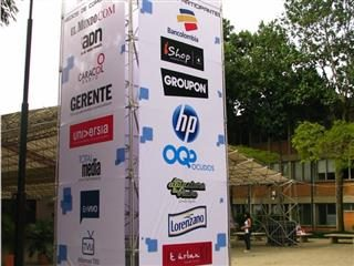 a makeshift structure with several brand logos.