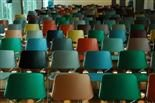 empty chairs of many colors in an auditorium