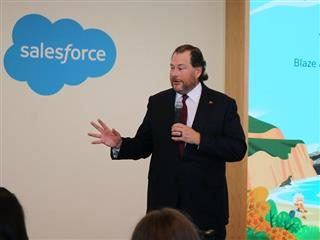 Salesforce CEO Marc Benioff speaking to a crowd of people.