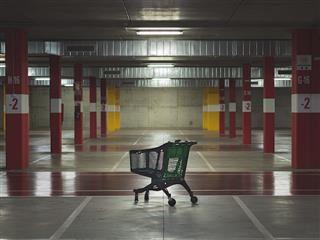 abandoned shopping cart in an empty parking garage