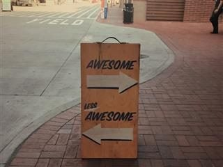 "sign with ""awesome, less awesome"" pointing in two different directions"