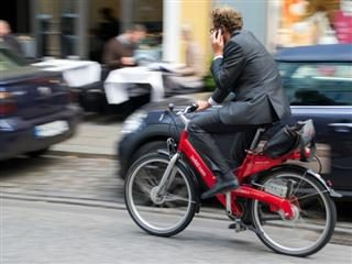 businessman on bike with phone