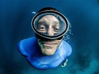 man taking photo of himself while scuba diving