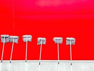 mop against a red background