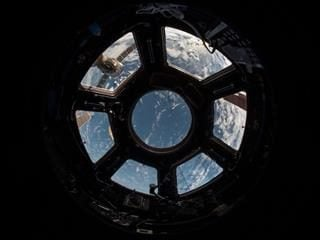 view of planet Earth from the window of the space shuttle
