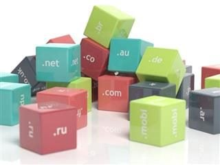 Colored plastic blocks with domain extensions printed on each one, isolated on a white background - domain name extension concept