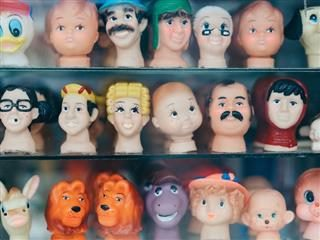 shelf with rubber heads of toys lined up