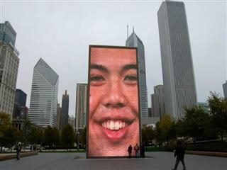fountain in Millenium Park, Chicago with resident's faces projected on it