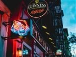 Blind Tiger Pub in NYC, with neon sign of tiger head and Guinness sign