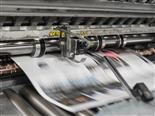 newspaper coming out of a printing press