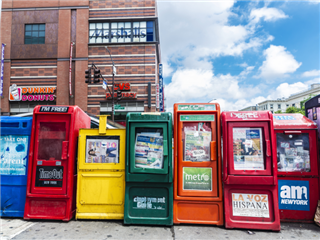6 differing automatic machine vending of newspapers in Manhattan, NY