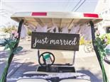 "golf cart with ""just married"" sign"