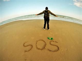 SOS written in the sand