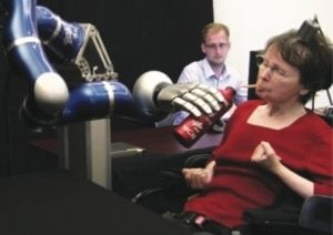 woman drinking with help of robotic arm