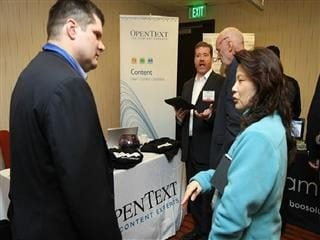 opentext officials at conference