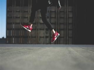 jumping with red sneakers on
