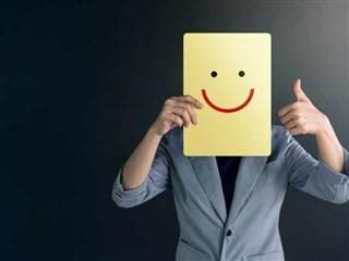 A man and a smiley face indicating a positive customer experience