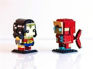 two lego figures of super heroes