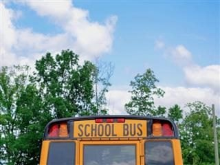 top of a school bus with blue skies overhead