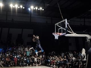 airborne basketball player taking a shot