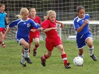 Determined girl soccer players