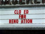 "movie marquis with sign ""closed for renovation"" (missing a few letters)"
